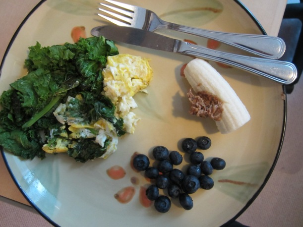 Breakkie of Champs! Kale, egg, banana, almond butter, blueberries